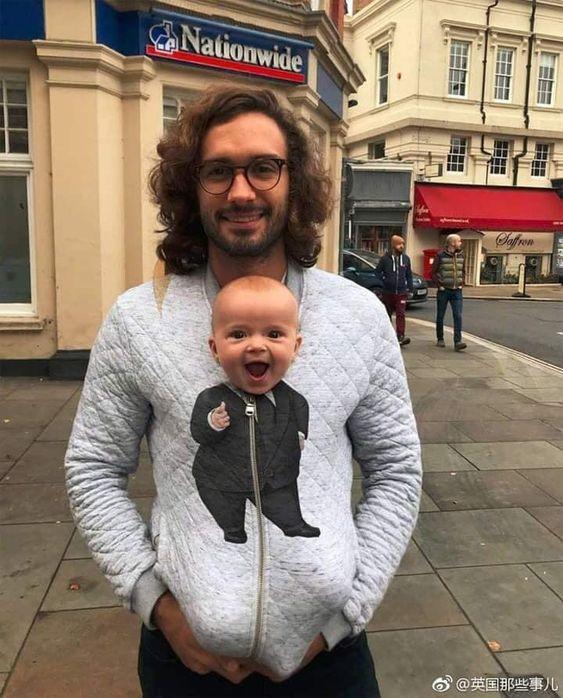 papá con bebé en invierno